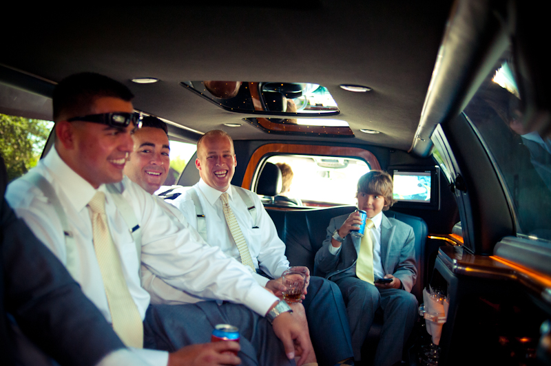 Groom and groomsmen in limo