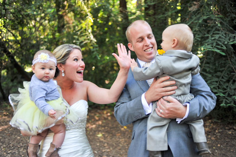 Bride and Groom holding babies