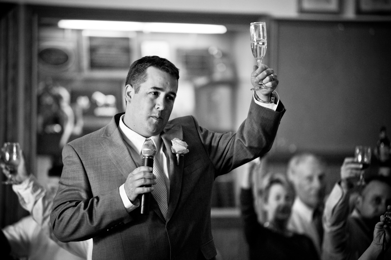 Best man raising glass for toast