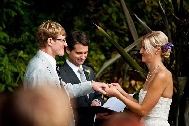 Bride and Groom exchanging rings during Lake Temescal wedding
