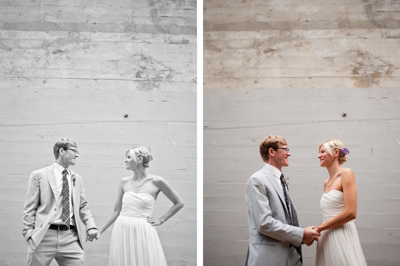 Bride and groom holding hands against grey wall in Oakland, CA