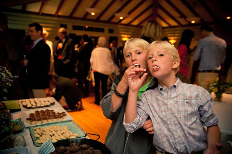 Young boys enjoying dessert bar at wedding