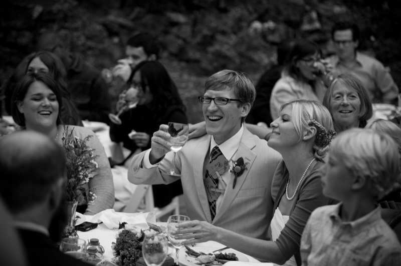 Bride and Groom listening to toasts at Lake Temescal wedding