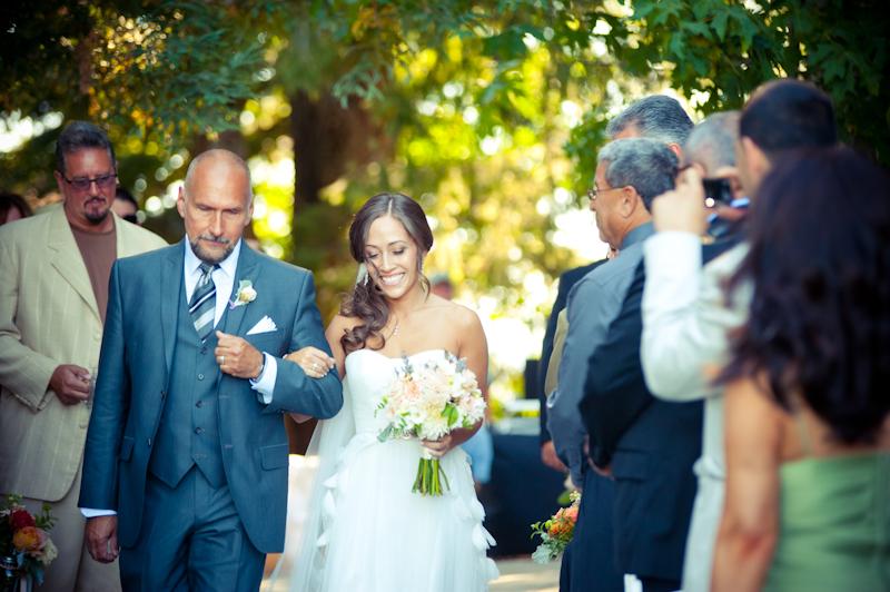 Bride walking down aisle at the Vine Hill House in Sebastapol, CA