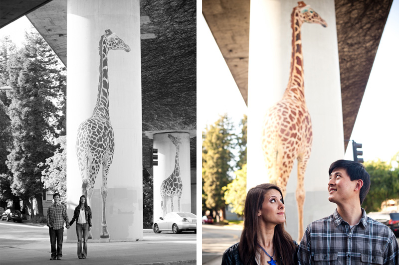 Couple looking at Oakland giraffe murals