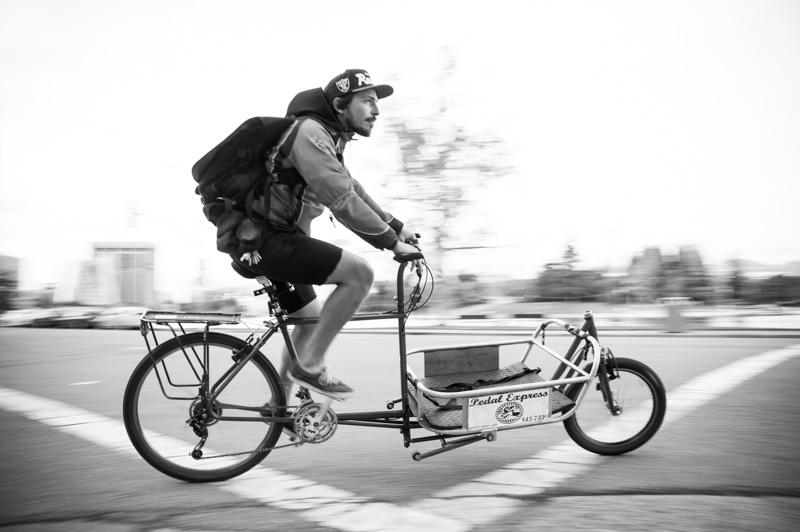 Action shot of bike messenger in Oakland, CA
