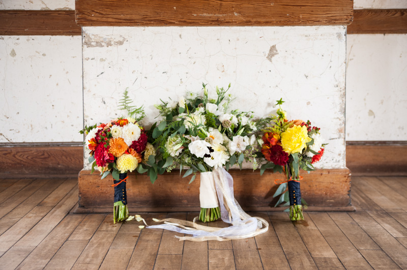 Bouquets all lined up on wooden floor
