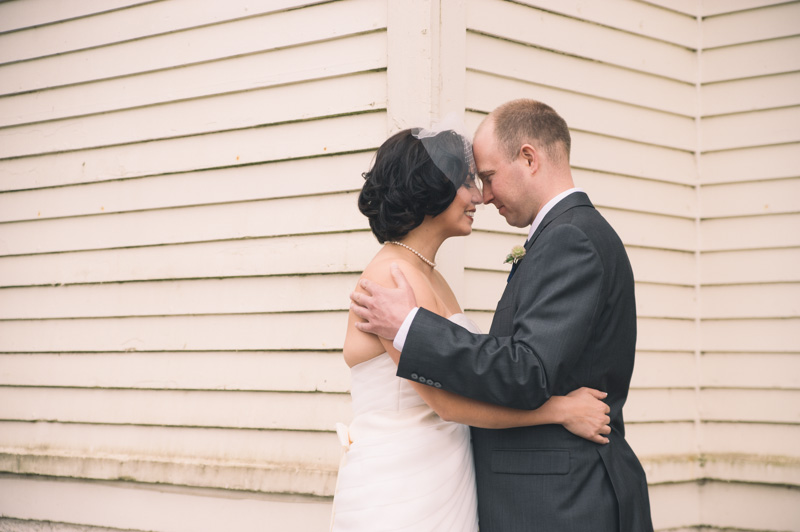 Bride and Groom touching embrace after first look