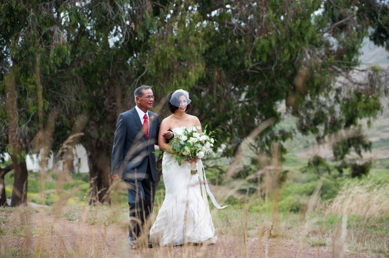 Bride walking down aisle with father in Marin, CA