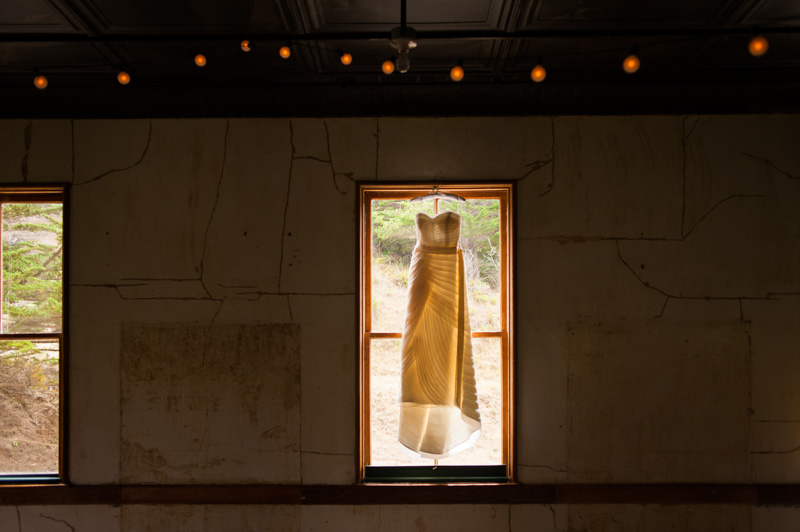 Wedding dress hanging in window at Headlands Center of the Arts