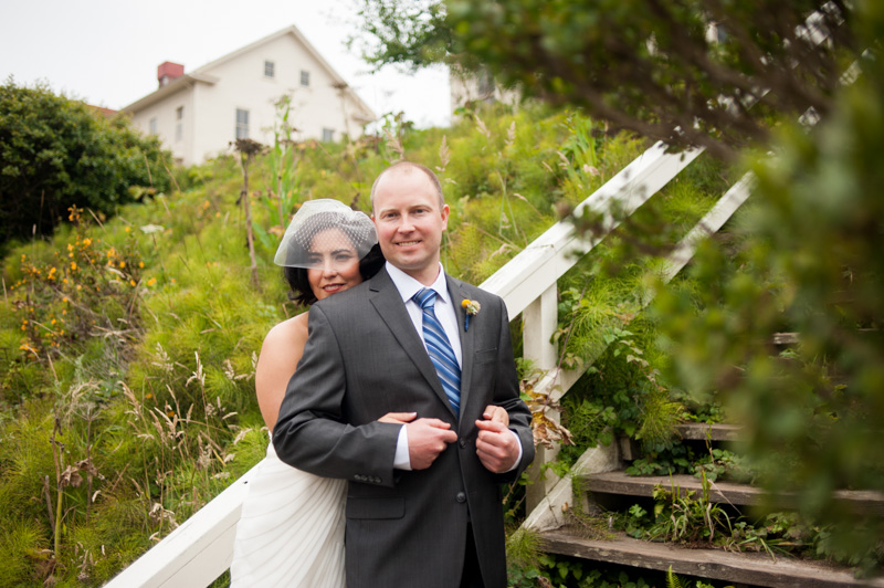 Bride and Groom on wooden stairs