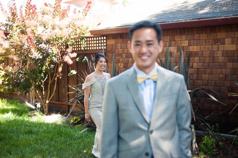 Bride and Groom during first look in Berkeley backyard