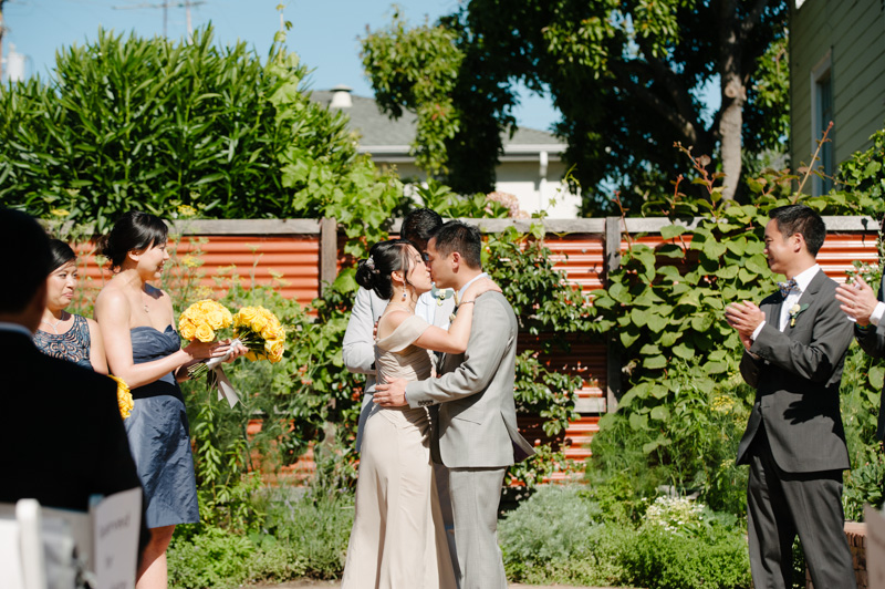 Bride and Groom's first kiss at Pizzaiolo wedding in Oakland