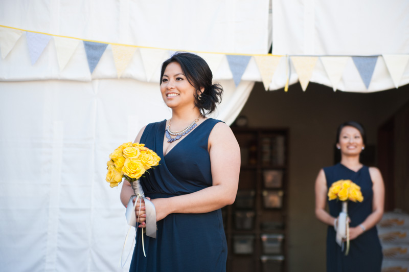 Bridesmaids walking down aisle at Pizzaiolo in Oakland