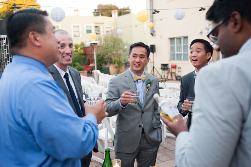 Groom toasting with friends in Oakland