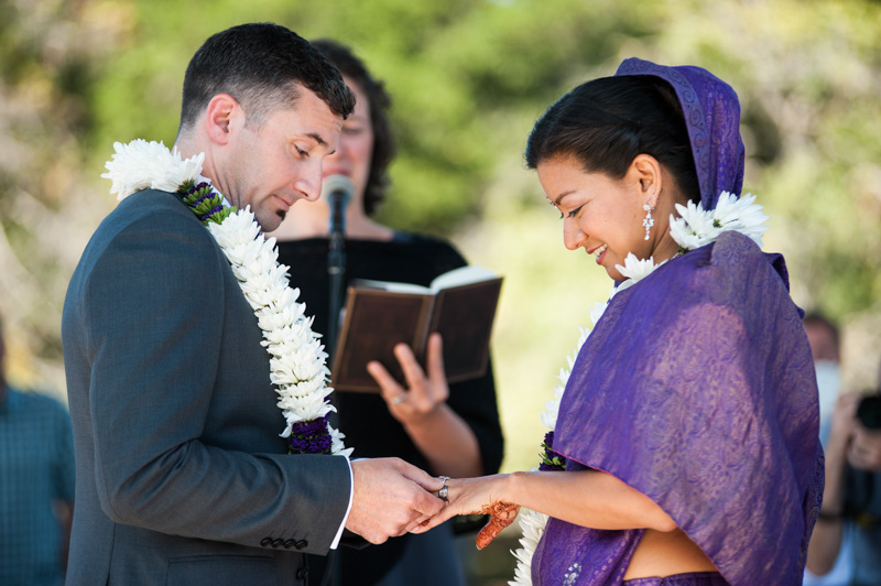 Exchanging of rings during wedding at Lake Merritt band stand in Oakland