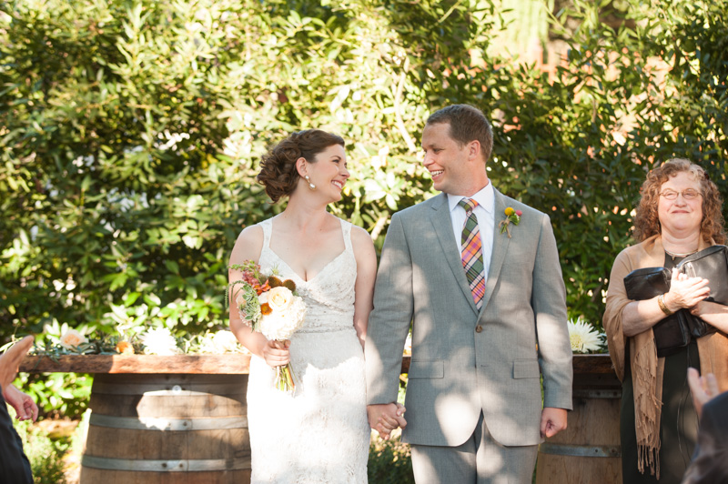 Bride and Groom walk down the aisle after wine country house wedding