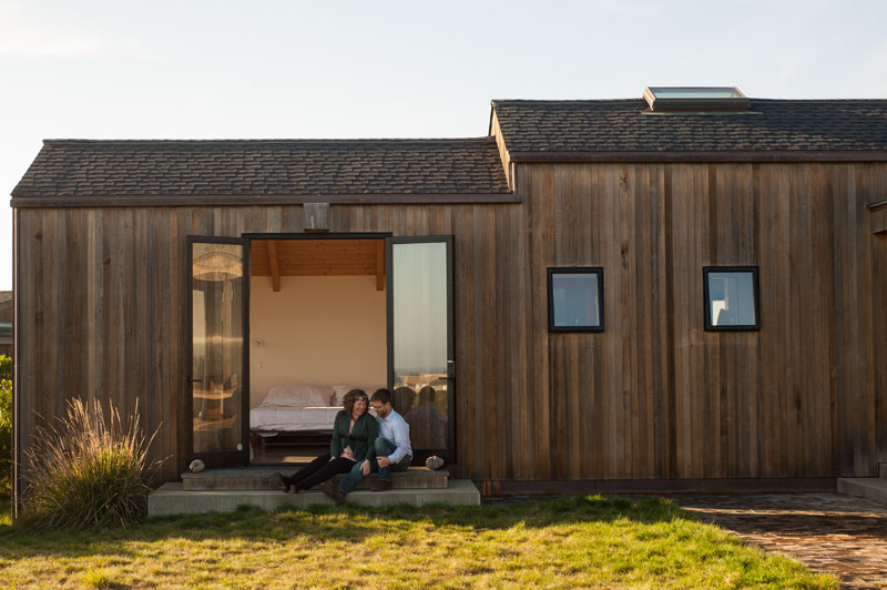Couple outside home in Sea Ranch