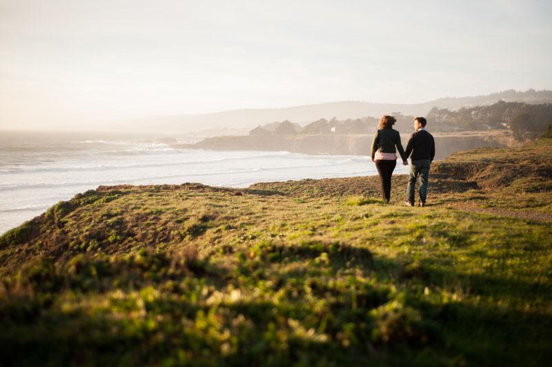 Bride and groom on ocean cliff in Sea Ranch