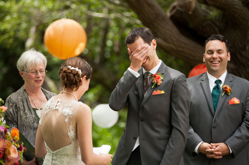 Groom doing a facepalm during wedding vows