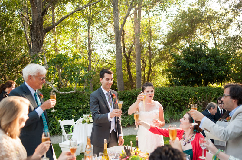 Bride and Groom toast with family at wedding