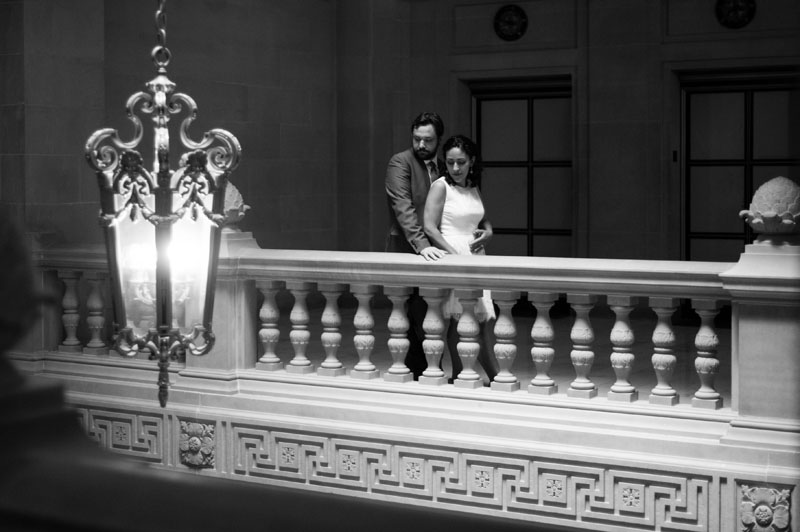 Black and white of Bride and Groom on balcony at San Francisco City Hall