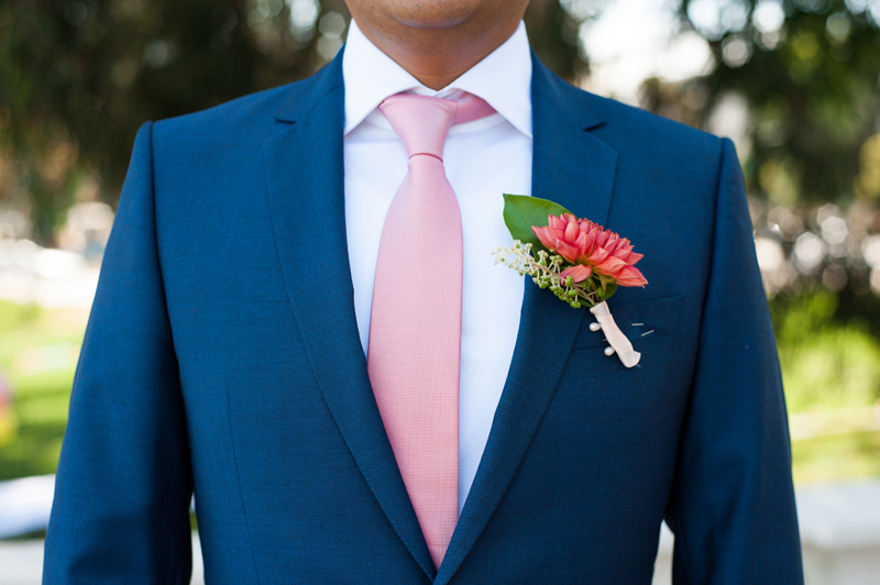 Detail of Groom's blue suit with pink tie