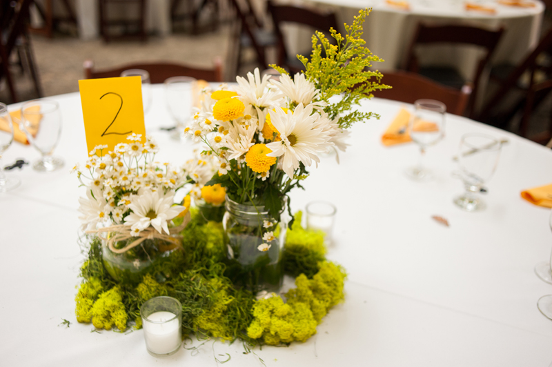 Wedding table arrangement with widlflowers