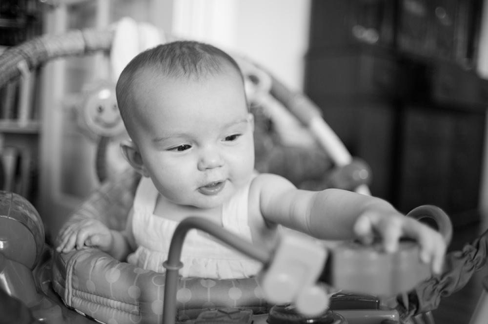 Baby girl grabbing toy