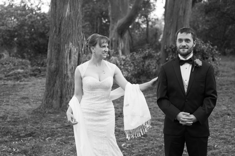 Bride seeing groom for the first time during first look in Golden Gate Park