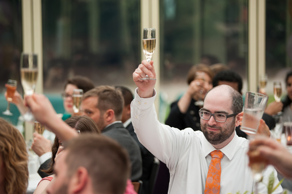 Guests raising theirs glasses