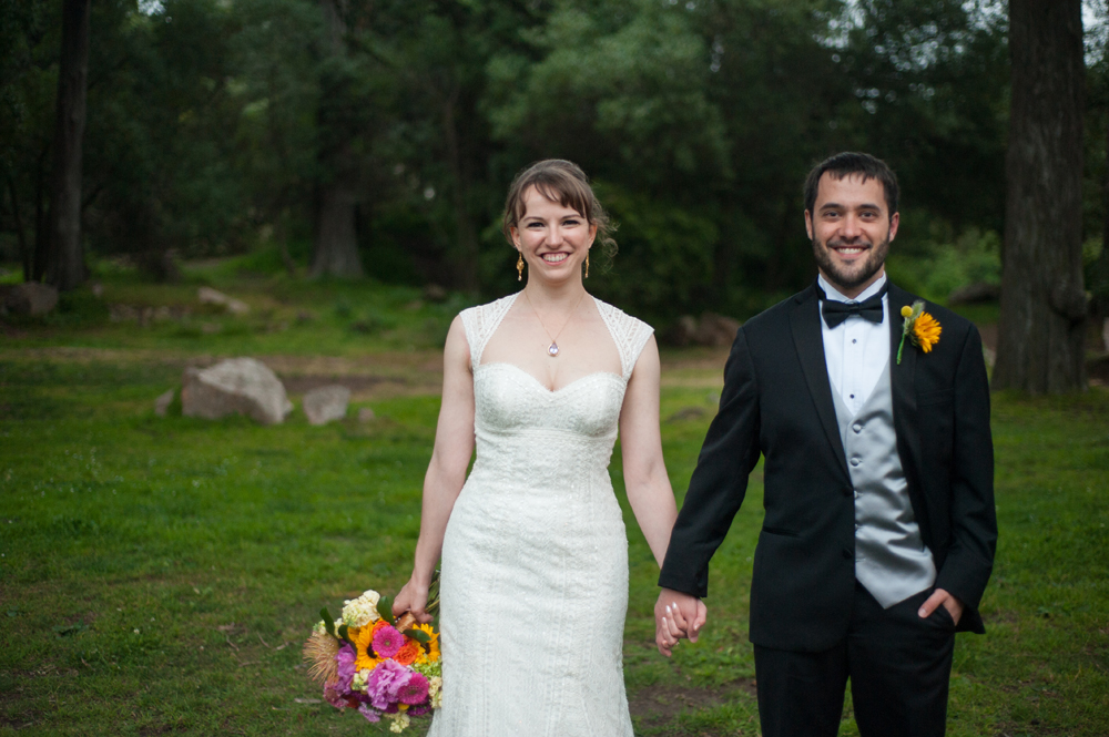 Bride and groom holding hands in Golden Gate Park