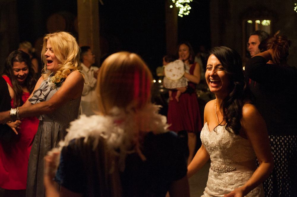 Candid of bride dancing at Murrieta's Well