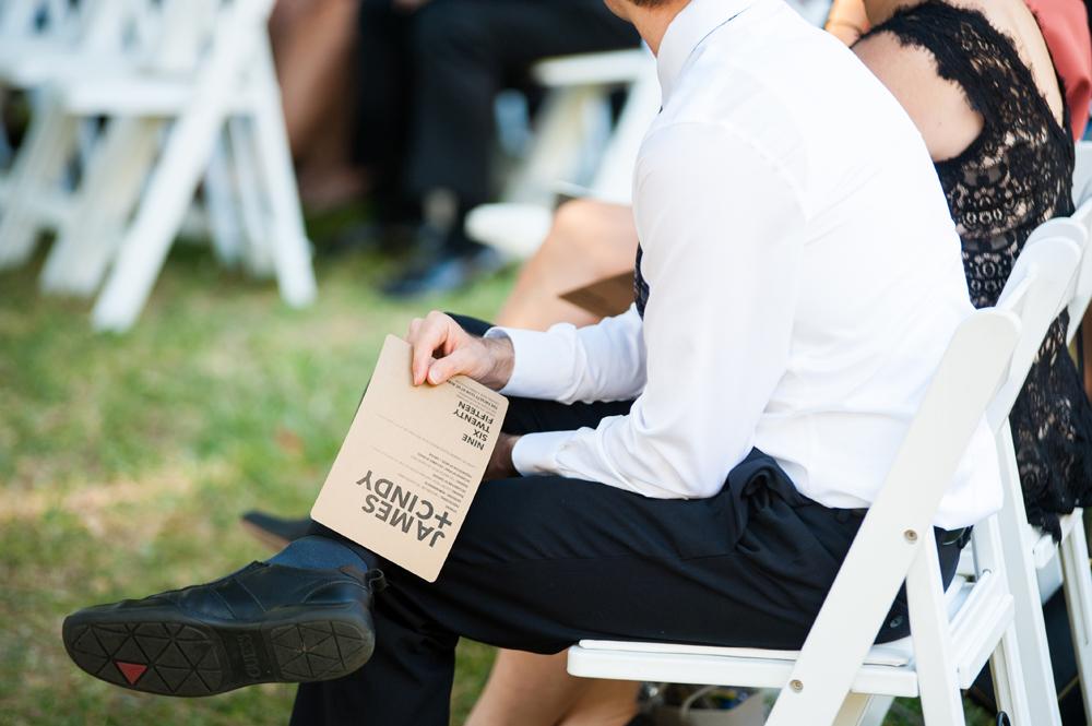 Guest holding wedding program at UC Berkeley Faculty Club