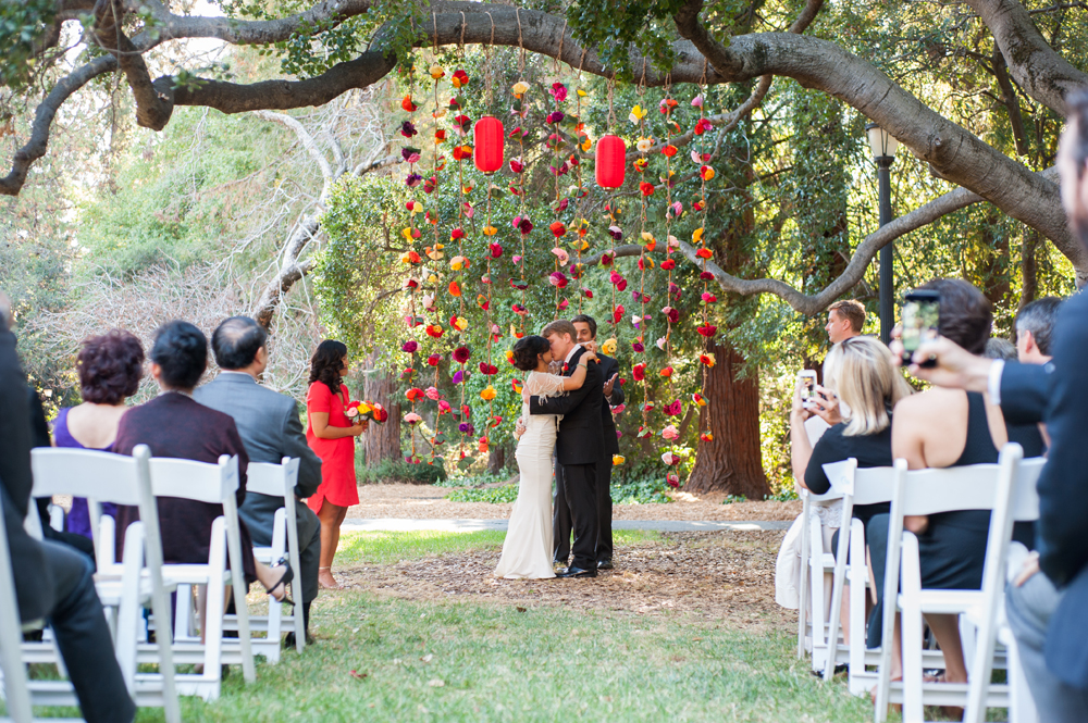 Bride and groom kiss during wedding ceremony at UC Berkeley