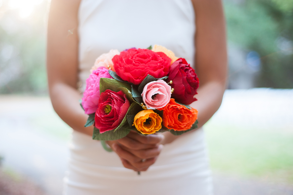 Bride holding bouquet of paper flowers at UC Berkeley