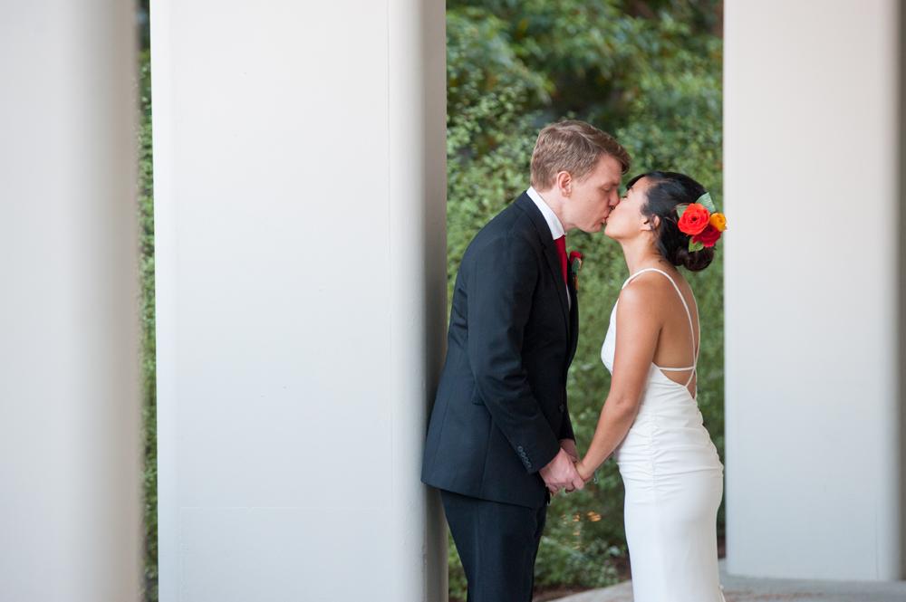 Wedding photo of bride and groom kissing on UC Berkeley campus
