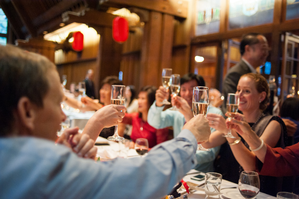 Wedding guests raise their glasses