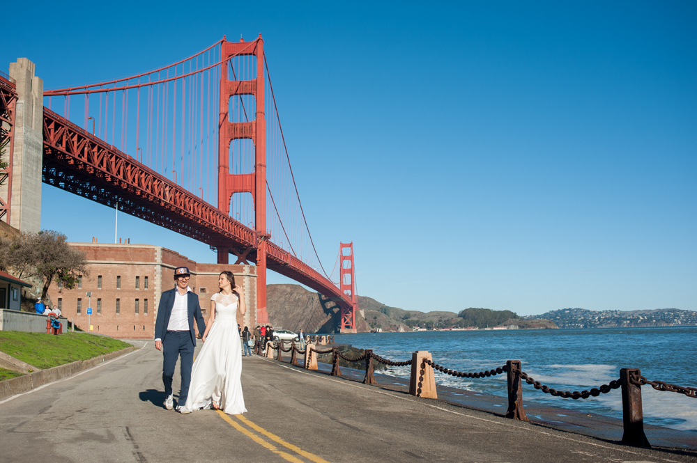 Young married couple under the golden gate bridge