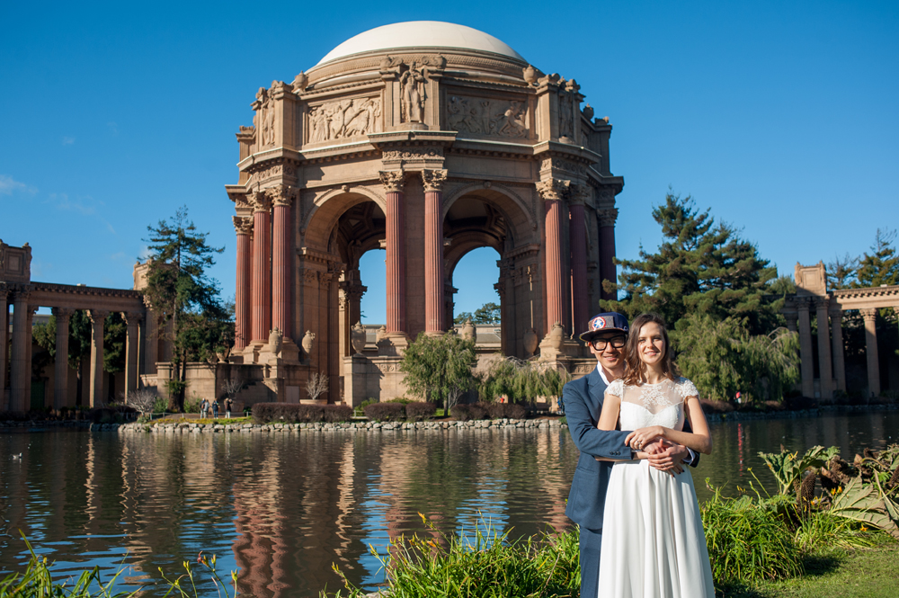 Bride and groom in front of Palace of Fine Arts