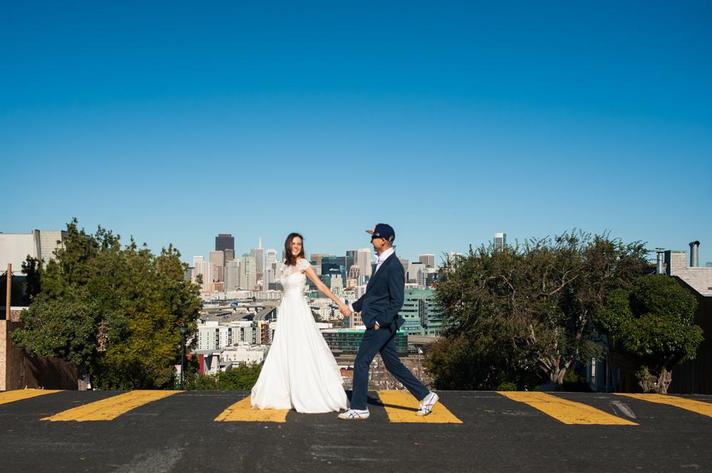 Just married couple walking across street in San Francisco