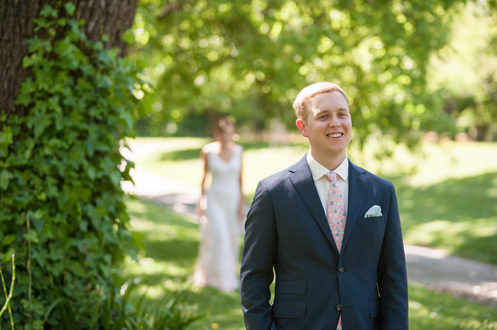 Groom waiting for bride during first look at Dawn Ranch wedding
