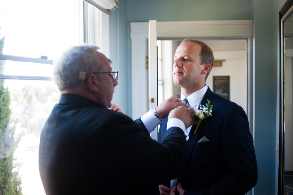 Father of Groom adjusting his tie at the Claremont Hotel