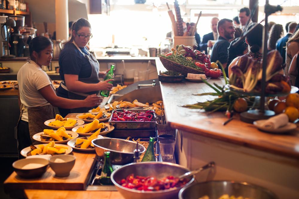 Restaurant staff preparing food for Pizzaiolo wedding