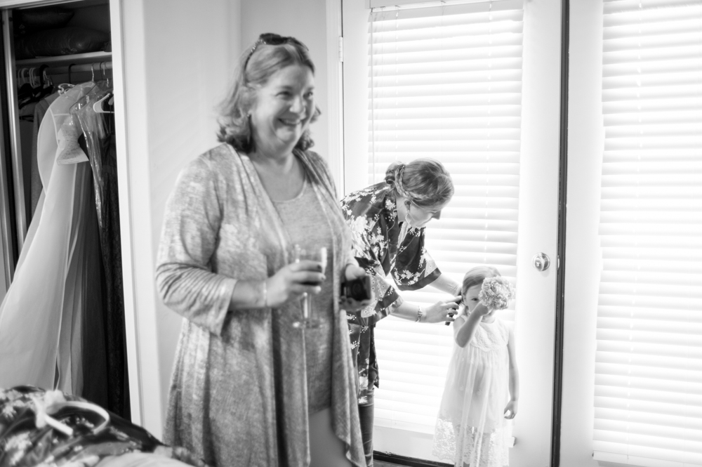 Candid of bridesmaid and mother of bride