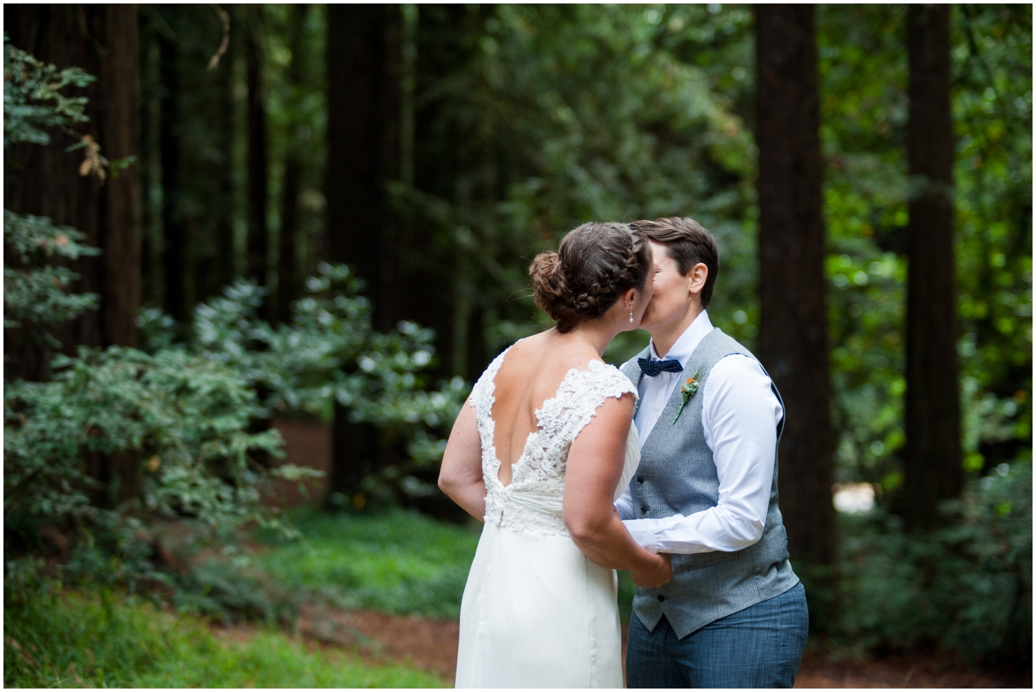 Couple kiss during first look in Oakland Hills