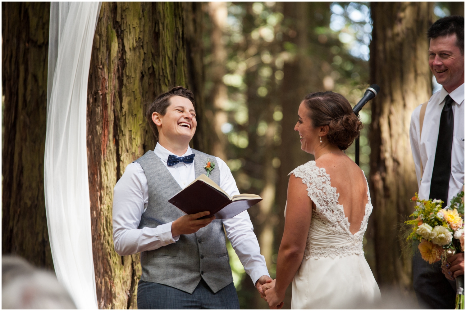 Couple laughing during wedding ceremony in the redwoods