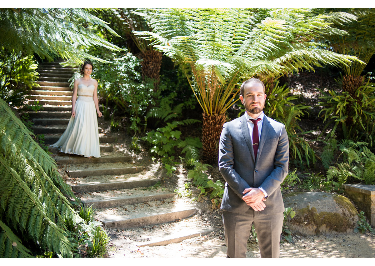 Bride walking down to steps during first look at Golden Gate Park