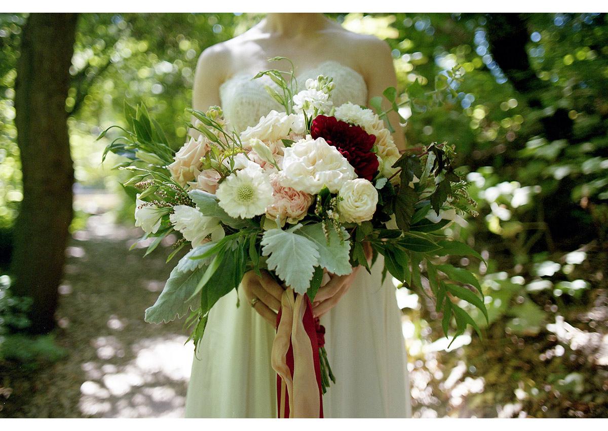 Detail photo of bride holding large flower bouquet