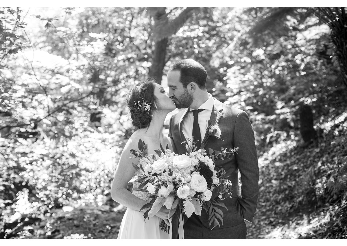 Black and white of bay area bride and Groom kissing